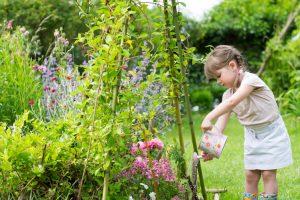 child-watering-garden-2
