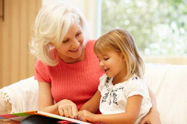 Grandmother and granddaughter reading